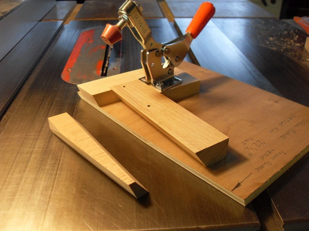 Wedge cutting fixture for use on the table saw.